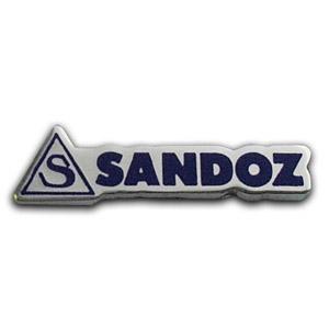 Серебряный значок компании SANDOZ